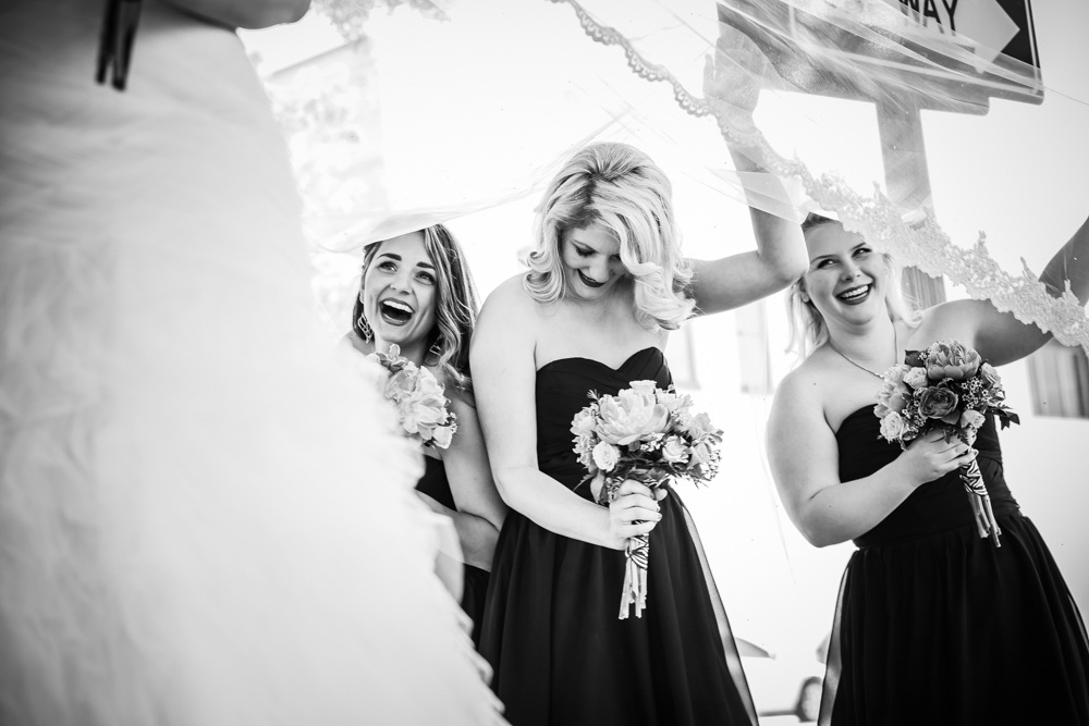 bridesmaids with veil blowing in wind